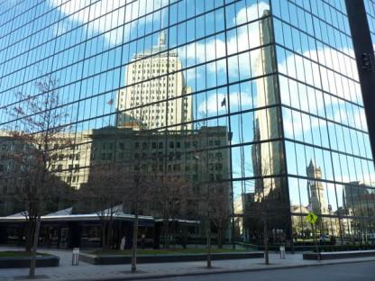 Lots of buildings reflected in the John Hancock building in Boston.