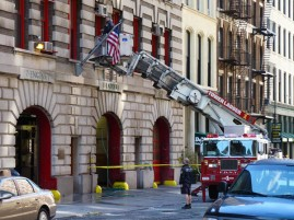 Engine Company 7 on Broadway in lower Manhattan. They're cleaning the windows.