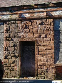 One of the boarded-up doors in the west armor.