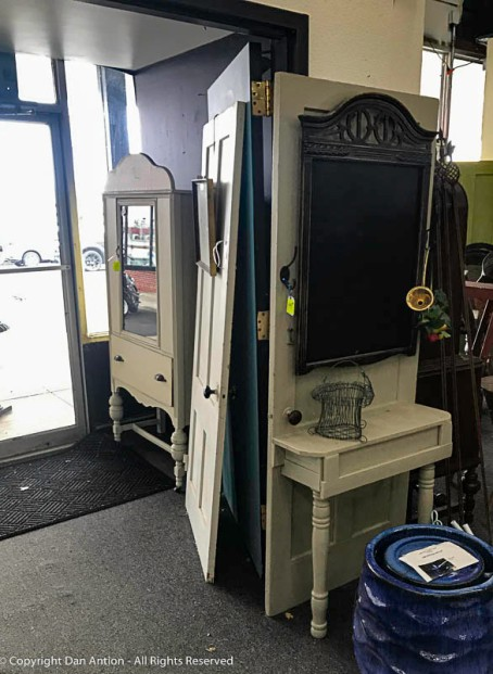 I stopped into a antique / used furniture shop just to look around. They have some doors for sale, and one that has been made into a piece of furniture.