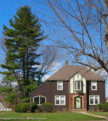 """The left side of this house has a shape that would be typical of a """"saltbox"""" style house if this was the back side."""