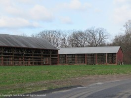 Within one day, the barn in the background was stripped of all the side walls.