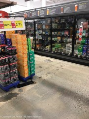 The beer cases are dark because beer can't be sold before 10:00 am and it's only 7:00 am.