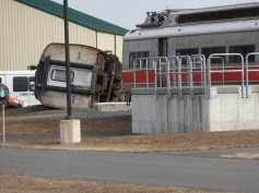 This purposely derailed train is staged at the National Guard training facility in our town.