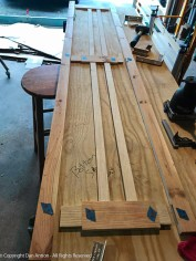 """The side slats have to be glued in place first. Then the rails and slats are assembled into the vertical """"legs"""""""