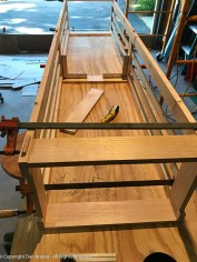 The case is held together with clamps. The arch will be drawn onto the upper front) rail of the bottom.