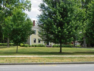 Even behind the trees, the Captain Charles Leonard House is stunning.