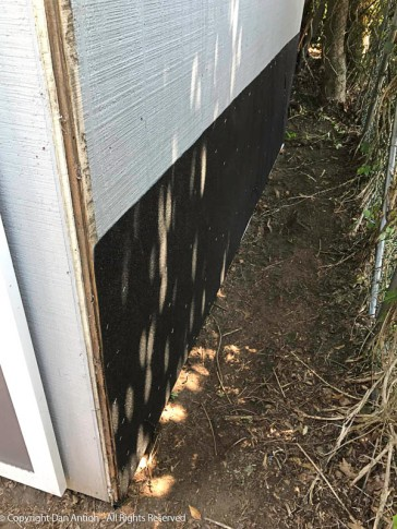 You can see how close the shed is to the fence. If you look closely at the bottom, you can see the PVC trim that was added to hold the membrane in place.