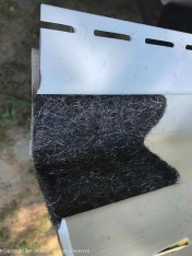 This heavy gauge steel wool is added at the bottom of the corner boards to prevent small critters from entering. A necessary precaution given how close to the ground the siding starts.