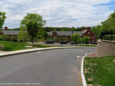This road is perpendicular to Main St (in front of the green) and shows how the school has grown to the west.