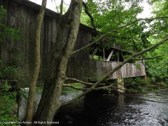 One covered bridge crosses the river's flow into the mill pond. This one crosses the river as it turns away from the pond.