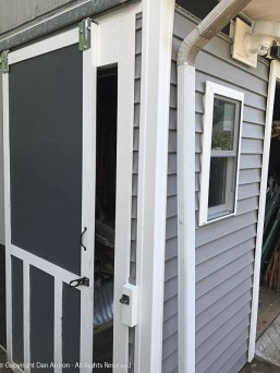 Siding strip complete and latch reinstalled.