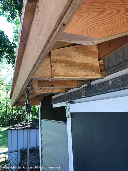 The lower brace on the rafters are secured to the upper rafter portion with screws and gusset plates that are stapled on.