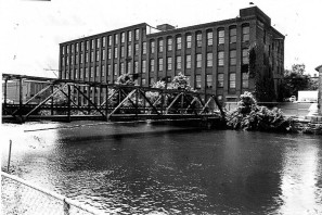 The George W. Prentiss & Company Wire Mill, back possibly built c. 1911, front 5 story section built 1917. The Prentiss company eventually moved to Homestead Avenue in 1962, and by 1965 the building was occupied by the Holyoke Die Cut Card Company, which owned the building until 2001. It has in recent years sat vacant under the ownership of a holding company.