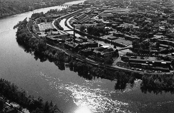An overview shot of The Flats and Holyoke Canal System before 1950 for the US Army Corps of Engineers project mitigating flooding in the canal districts and Springdale.