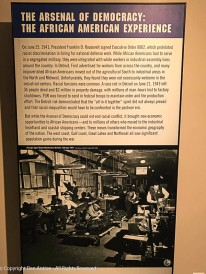 "On June 25, 1941, President Roosevelt signed an executive order prohibiting racial discrimination in hiring for national defense work. The military remained segregated but industrial assembly lines were integrated. This was not without conflict. Racial tensions were common and a race riot in Detroit caused over $2 million in property damage and resulted in 34 deaths. This poster mentions that ""racial inequalities would have to be confronted in the postwar era."" That continues to be necessary today. However, the Arsenal of Democracy transformed the industrial heartland and economic geography of the nation."