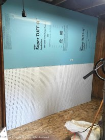 New floor and peg board to finsih the inside of the shed.