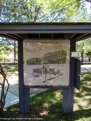 Description and map of Holyoke Heritage Park. The information is behind glass doors.