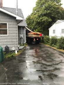 That's my lumber. It arrived in the rain. That long board on top was supposed to be cut into sections before delivery. Those instructions were misplaced.