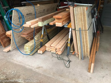 The lumber was moved inside and separated so it could dry. Some of this was removed from the space being converted.