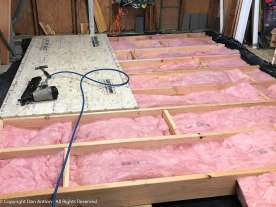 Floor joists rest on the sleepers. The insulation was left over from a previous project. This seemed like a good place to use it.