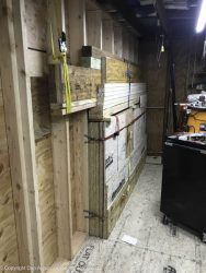 That's the partition wall between the garage and the shop. That pile of lumber is everything that's required to finish the conversion. It has to sit there for a bit.