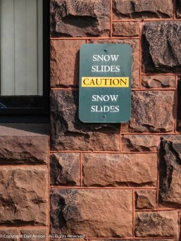 You have to get used to this sign in New England. Especially on tall buildings with slate roofs.
