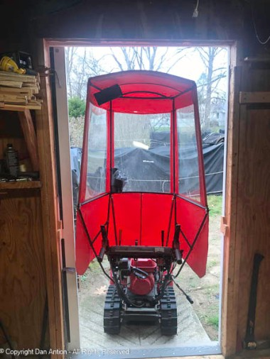 Raising the header of the shed's main door worked. I no longer need to tip the snow blower when backing it in. We are now ready for winter.
