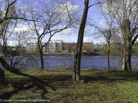 The leaves are gone, The river is up and the apartments are finished.