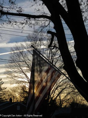 Those contrails have all faded, but they are still visible behind the flag.