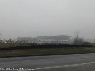 This is the new Amazon warehouse under construction on a wet foggy day.