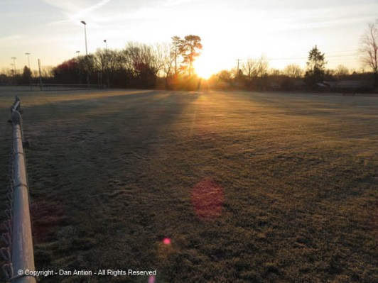 Sunrise over the soccer field.