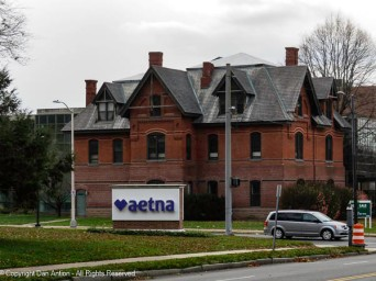 As I recall (I can't find the history) this building was to be demolished to make room for the Aetna Training center. The steel and glass building was joined to this building instead.