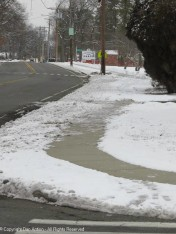 Some neighbors wait for the sun to clear the walk. The way the temp is heading, this will be a mess for several days.