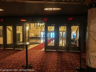 Looking out from the orchestra lobby into the main lobby and street entrance.