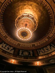 The chandelier is a recreation that hangs from the restored parabolic dome over the theater.