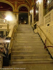 One of the staircases up to the mezzanine. The walls are a faux marble painted finish. The stairs are real marble. The balustrade is plaster, painted to match the walls.