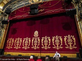 In many ways, it functions as a door. Hand painted and weighing 1s000 lbs (453.6 kg), it is a magnificent curtain.