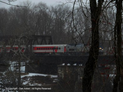 AMTRAK loco pulling CT Rail's Hartford line across the Windsor Locks Canal.