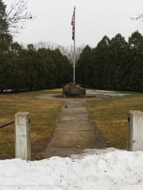 Early in the week, the flag was at full staff and the snow pile was still pretty high.