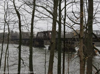 The railroad trestle over the Connecticut River and the Windsor Locks Canal. The large truss bridge allows boat traffic along the river.