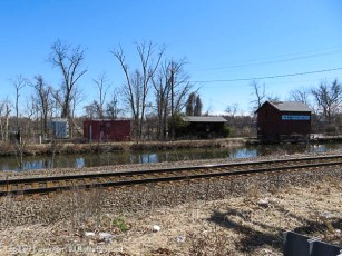 Taken from Rt-159. The railroad tracks and the canal. The building on the right is the old Canal operation office. Stretched above are the high voltage lines carrying electricity over the river.