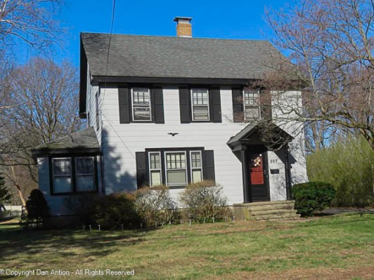 Colonial Revival with pedimented portico,