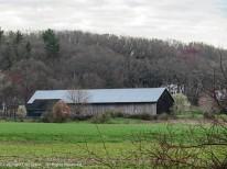 A small barn and a tobacco barn.