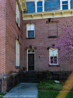 I like the narrow door and the ghost window.