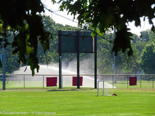 The heat and dry conditions (before the rain) have required the sprinklers on the ball field.