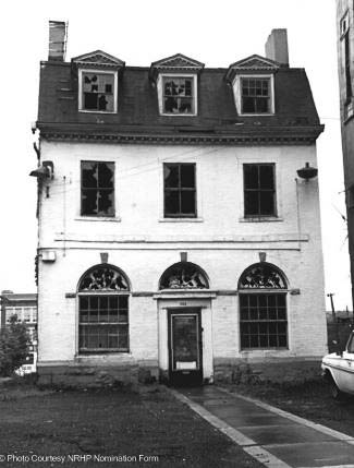 The house, in 1968 when it was facing Main Street at being slated for demolisoin in the name of Urban Renewal.