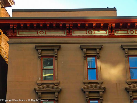 I love the details along the frieze, roof line and the windows.