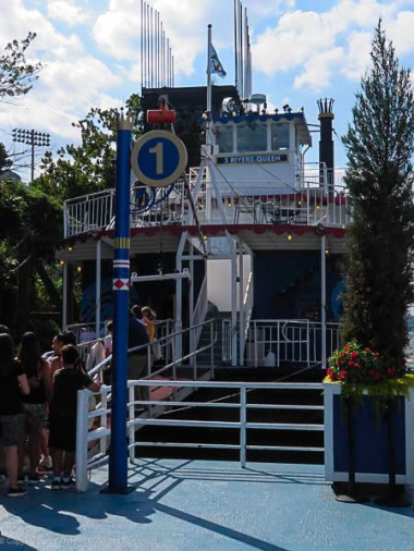 Entry door to the 3 Rivers Queen. People are getting ready for a sightseeing cruise.