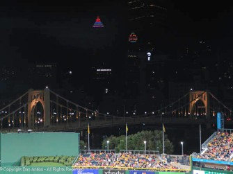 The view over centerfield - The Roberto Clemente bridge and the Gulf Building's weather-indicating roof reflected in the UPMC building.